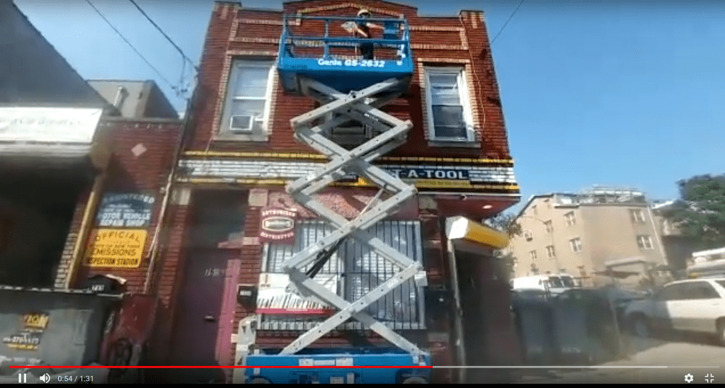 tool rental in brooklyn, ny | scissors lift - man on platform