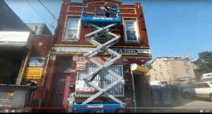 tool rental in brooklyn, ny | scissors lift - man on platform